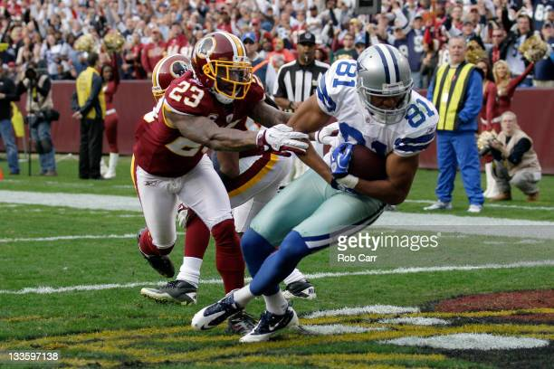 Laurent Robinson of the Dallas Cowboys catches a touchdown pass in front of DeAngelo Hall of the Washington Redskins during the second half at...