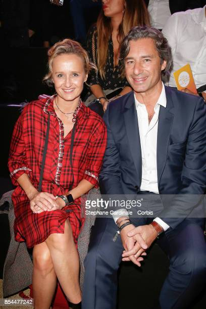 Laurent Solly and his wife Caroline Roux attends the Etam show as part of the Paris Fashion Week Womenswear Spring/Summer 2018 at on September 26...