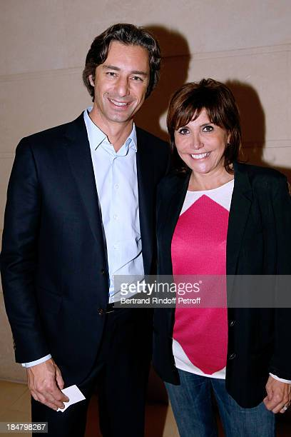 Laurent Solly and singer Liane Foly attend the JeanPaul Moureau book signing for 'Soigner Autrement' at Hotel Park Hyatt Paris Vendome on October 16...