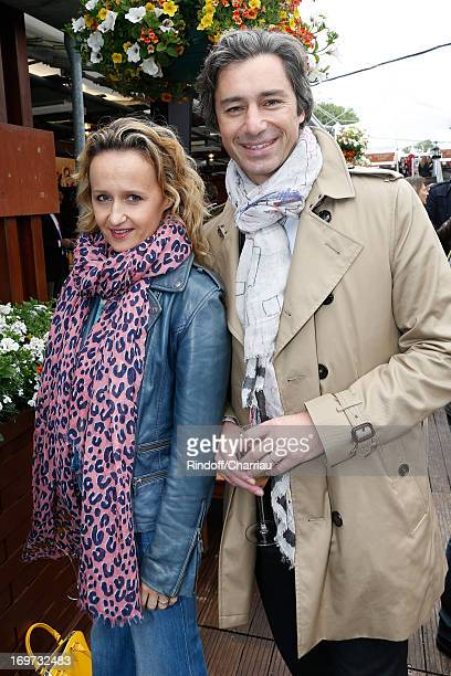 Laurent Solly and wife Caroline Roux attend Roland Garros Tennis French Open 2013 Day 6 on May 31 2013 in Paris France