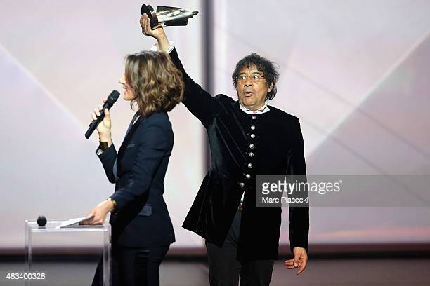 Laurent Voulzy receives from Virginie Guilhaume the album of songs award for 'Alain Souchon Laurent Voulzy' during the 30th 'Victoires de la Musique'...