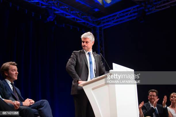 Laurent Wauquiez president of AuvergneRhonesAlpes regional council stands next to Francois Baroin French rightwing Les Republicains party senator and...