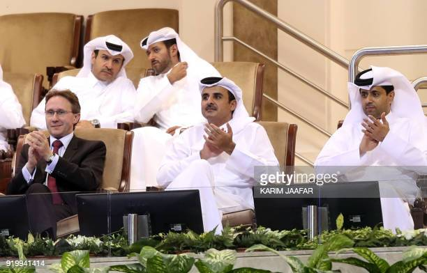 Laurent Wolffsheim Managing Director of Total EP Golfe and Group Representative Qatari Emir Sheikh Tamim bin Hamad alThani and President of the Qatar...