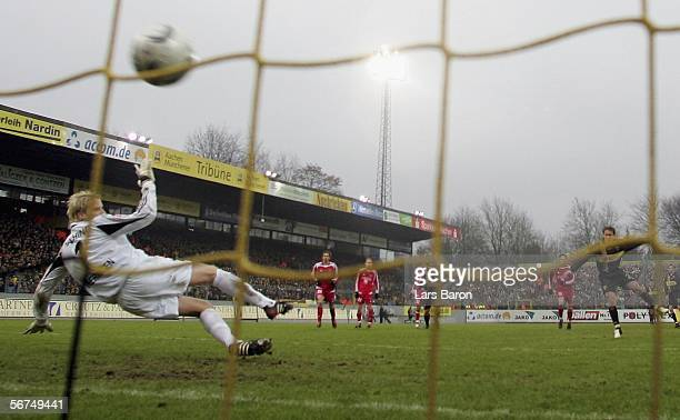 Laurentiu Reghecampf of Aachen scores the first goal from the penalty spot past goalkeeper Phillip Heerwagen of Unterhaching during the Second...
