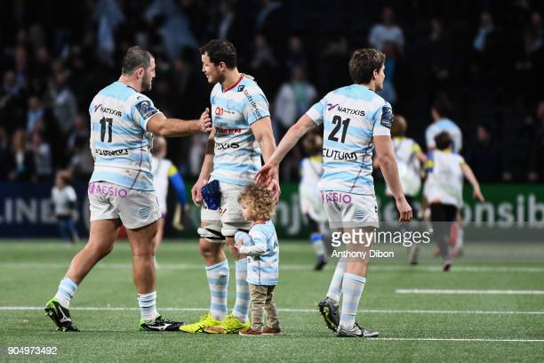 Lauret Wenceslas and his daughter congratulates by his team mates Vasil Kakovin and Xavier Chauveau during the Champions Cup match between Racing 92...