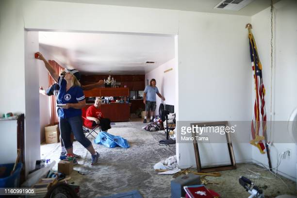 Laurette Eldridge and mother Anna Sue Eldridge laugh while packing up belongings in Anna Sue's home which has been deemed uninhabitable due to...