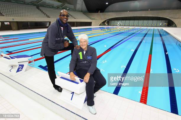 Laureus Academy Chairman Edwin Moses and Laureus Academy mamber Dawn Fraser pose for a picture at the London 2012 Olympics Aquatics Centre during the...