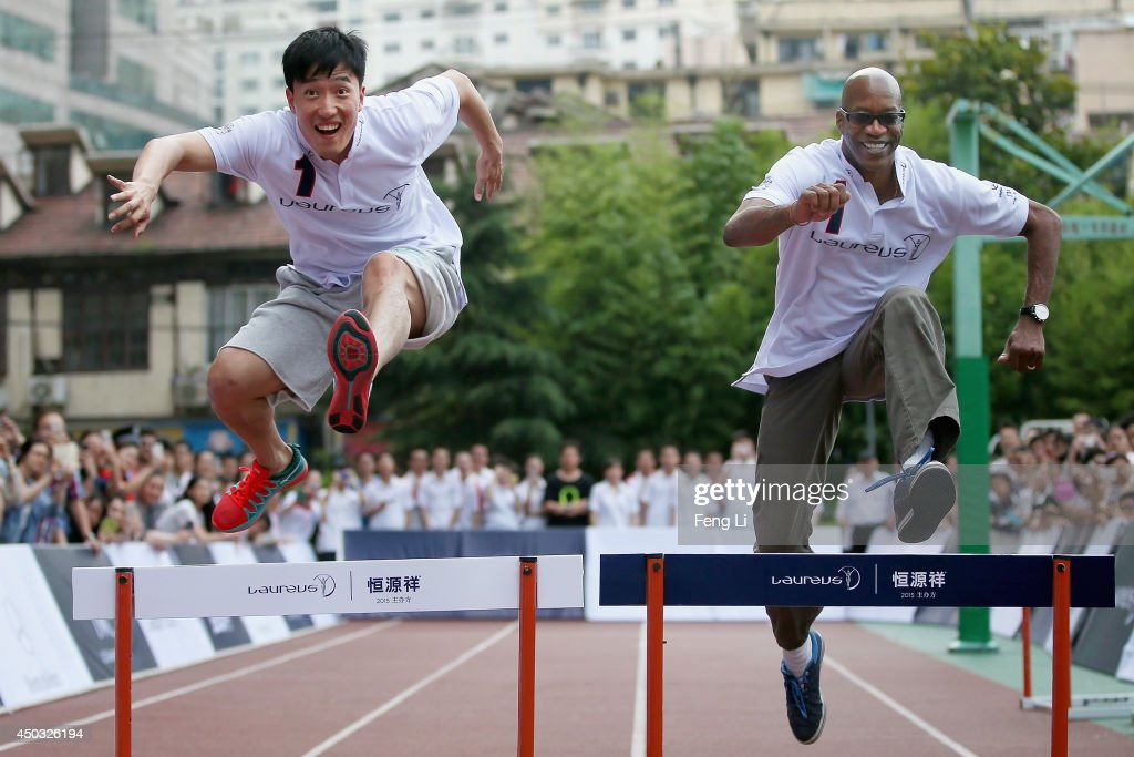 Laureus Academy Chairman Edwin Moses and Olympic 110m hurdle champion Liu Xiang (L) stage huddle race performance together during a physical education class at Gezhi Middle School on June 9, 2014 in Shanghai, China. Laureus World Sports Academy announces that the 2015 Laureus World Sports Awards will be held in Shanghai, China.