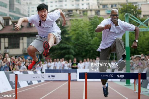 Laureus Academy Chairman Edwin Moses and Olympic 110m hurdle champion Liu Xiang stage huddle race performance together during a physical education...