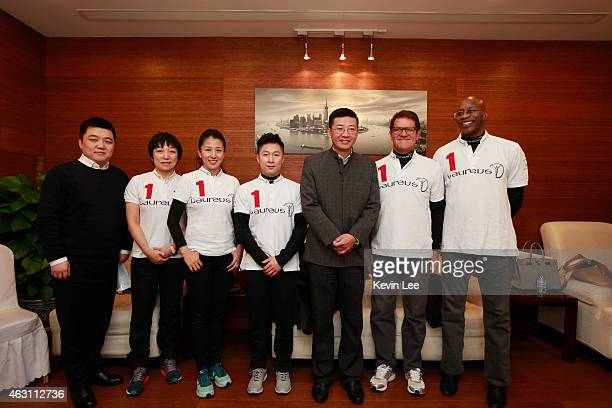 Laureus Academy Chairman Edwin Moses Yang Yang Li Xiao Ping Laureus Ambassador Fabio Capello Sun Wen and Chinese sponsors pose for a picture at the...