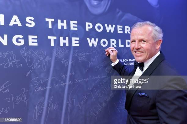 Laureus Academy Chairman Sean Fitzpatrick by the Nelson Mandela wall during the 2019 Laureus World Sports Awards on February 18 2019 in Monaco Monaco