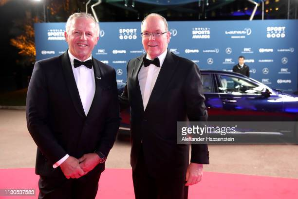 Laureus Academy Chairman Sean Fitzpatrick with Albert II Prince of Monaco poses on the red carpet during the 2019 Laureus World Sports Awards on...