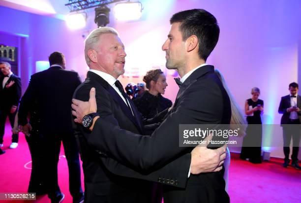 Laureus Academy Member Boris Becker and Laureus World Sportsman of The Year 2019 Nominee Novak Djokovic greet each other during the 2019 Laureus...