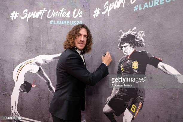 Laureus Academy Member Carles Puyol signs the wall attend the 2020 Laureus World Sports Awards at Verti Music Hall on February 17 2020 in Berlin...
