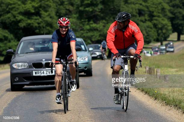 Laureus academy member Daley Thompson gives instructions during a triathlon training session for elite athletes on June 19 2010 in Richmond Park...