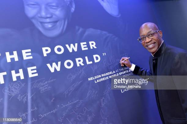 Laureus Academy Member Edwin Moses signs the wall at the 2019 Laureus World Sports Awards on February 18 2019 in Monaco Monaco