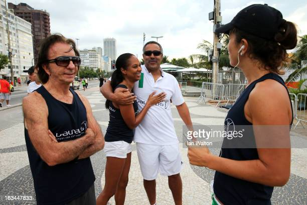 Laureus Academy Member Emerson Fittipaldi with Michelle Moses and Laureus Academy Member Daley Thompson during the Laureus Run Copacabana Beach on...
