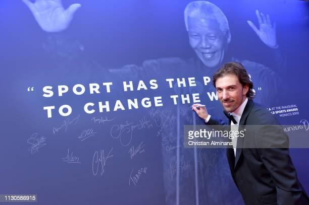 Laureus Academy Member Fabian Cancellara signs the wall at the Laureus World Sports Awards on February 18 2019 in Monaco Monaco