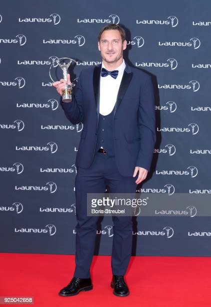 Laureus Academy Member Francesco Totti holds his award for Laureus Exceptional Achievement at Salle des Etoiles Sporting MonteCarlo on February 27...