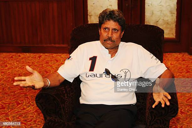 Laureus Academy Member Kapil Dev speaks during a press interview ahead of the 2014 Laureus World Sports Awards at the ShangriLa Hotel on March 25...