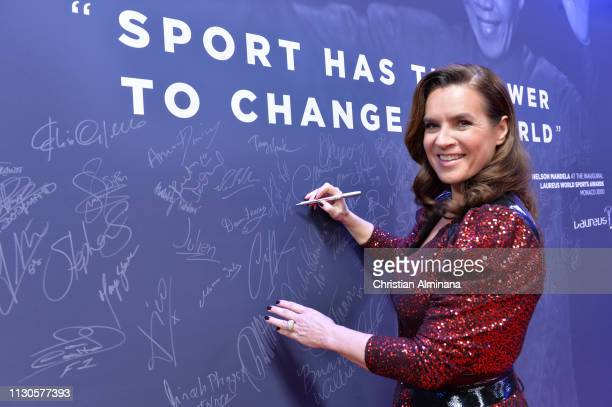 Laureus Academy Member Katarina Witt signs the Nelson Mandela wall during the 2019 Laureus World Sports Awards on February 18 2019 in Monaco Monaco