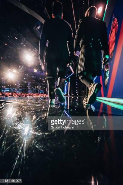 Laureus Academy Member Li Xiaopeng with Laureus Ambassador David Coulthard walk onstage during the 2019 Laureus World Sports Awards at the Salle des...