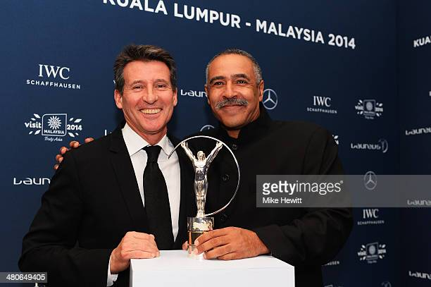 Laureus Academy member Lord Sebastian Coe and Daley Thompson attends the 2014 Laureus World Sports Awards at the Istana Budaya Theatre on March 26...