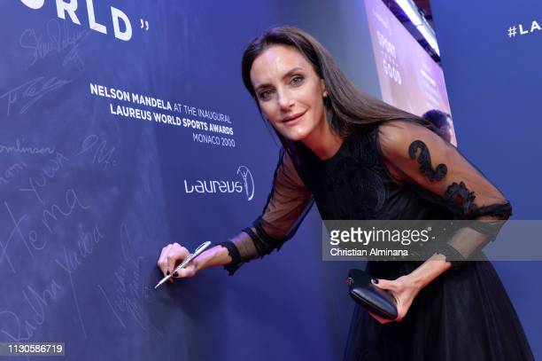 Laureus Academy Member Luciana Aymar signs the wall during the 2019 Laureus World Sports Awards on February 18 2019 in Monaco Monaco