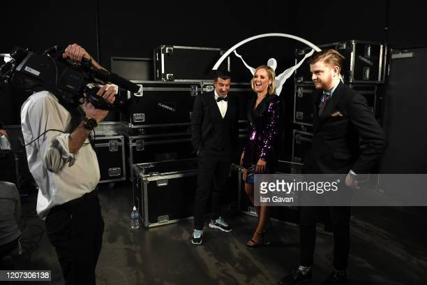 Laureus Academy Member Luis Figo and cohost Amanda Davies talk backstage during the 2020 Laureus World Sports Awards at Verti Music Hall on February...