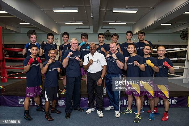 Laureus Academy Member Marvelous Marvin Hagler poses for a picture with Operation Breakthrough staffs and members at Hong Kong Police Boxing Club at...