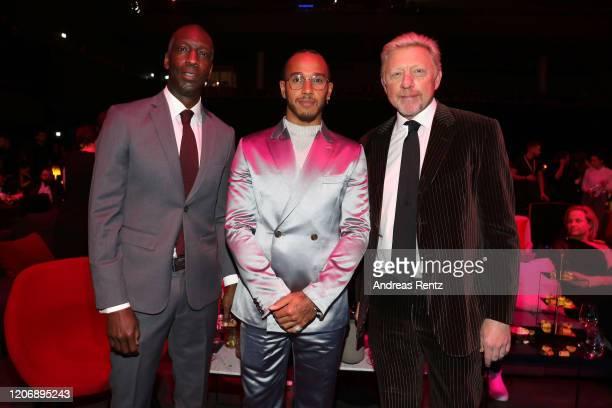 Laureus Academy Member Michael Johnson Laureus World Sportsman of the Year nominee Lewis Hamilton and Laureus Academy Member Boris Becker attends the...