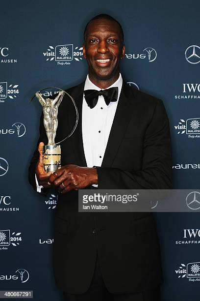 Laureus Academy member Michael Johnson poses with the trophy during the 2014 Laureus World Sports Awards at the Istana Budaya Theatre on March 26...