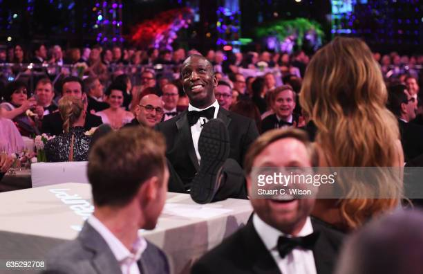Laureus Academy member Michael Johnson shows his trainers during the 2017 Laureus World Sports Awards at the Salle des EtoilesSporting Monte Carlo on...