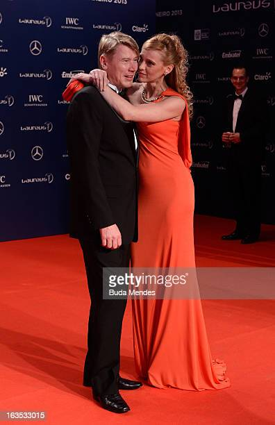 Laureus Academy Member Mika Hakkinen and guest attend the 2013 Laureus World Sports Awards at the Theatro Municipal Do Rio de Janeiro on March 11...