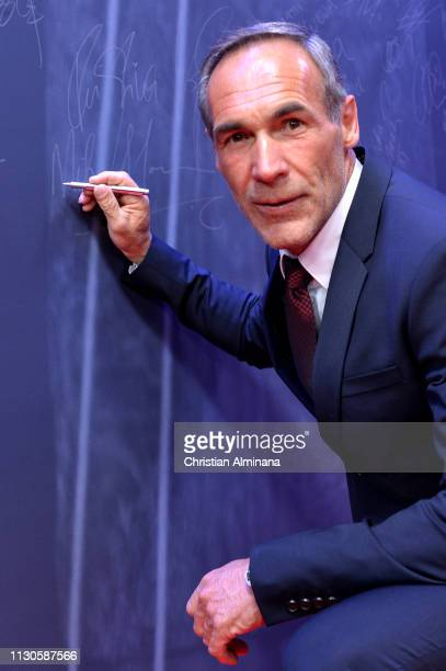 Laureus Academy Member Mike Horn signs the wall during the 2019 Laureus World Sports Awards on February 18 2019 in Monaco Monaco