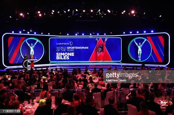 Laureus Academy Member Nadia Comaneci announces the Laureus World Sportswoman of The Year 2019 winner on stage with Laureus Academy Member Cathy...