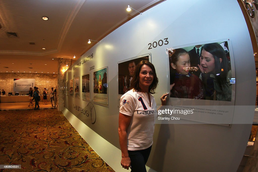 Laureus Academy member Nadia Comaneci	poses at the Fifteen Years of Laureus Exhibition ahead of the 2014 Laureus World Sports Awards at the Shangri-la Hotel on March 26, 2014 in Kuala Lumpur, Malaysia.