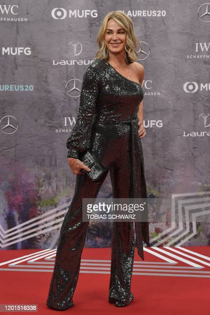Laureus Academy member Nadia Comaneci poses on the red carpet prior to the 2020 Laureus World Sports Awards ceremony in Berlin on February 17 2020