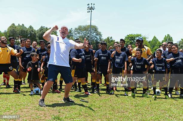 Laureus Academy Member Sean Fitzpatrick leads a 'haka' alongside players during the LWSA COBRA Rugby Project Visit ahead of the Laureus World Sports...