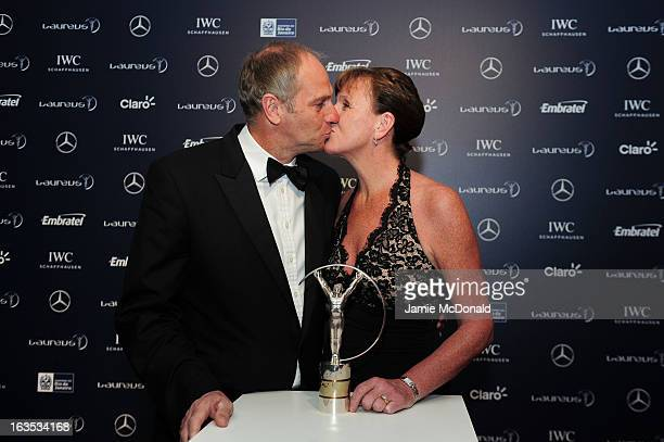 Laureus Academy Member Sir Steve Redgrave and guest pose with the trophy at the 2013 Laureus World Sports Awards at the Theatro Municipal Do Rio de...