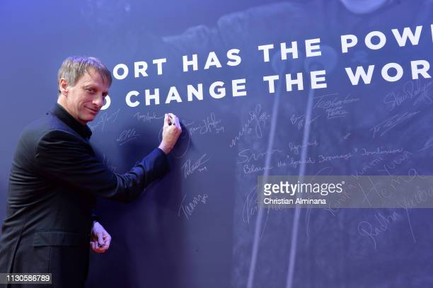 Laureus Academy Member Tony Hawk signs the wall during the 2019 Laureus World Sports Awards on February 18 2019 in Monaco Monaco