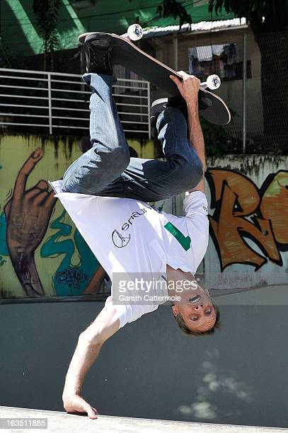Laureus Academy Member Tony Hawk skateboards with local children at the Laureus visit to Rocinha during the 2013 Laureus World Sports Awards on March...