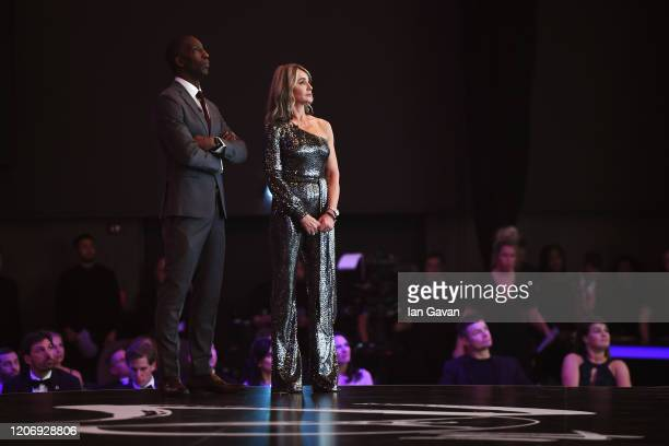 Laureus Academy members Michael Johnson and Nadia Comaneci speak on stage during the 2020 Laureus World Sports Awards at Verti Music Hall on February...