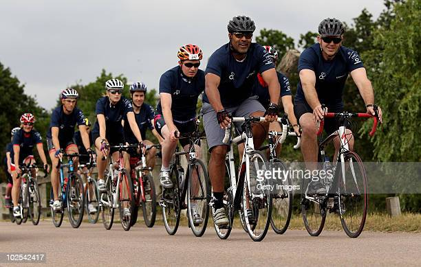 Laureus academy members Sean Fitzpatrick and Daley Thompson lead the pack during a triathlon training session on June 19 2010 in Richmond Park London...
