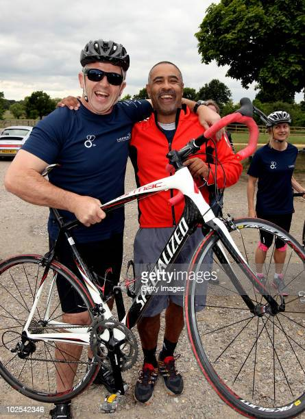 Laureus academy members Sean Fitzpatrick and Daley Thompson take a break during a triathlon training session for elite athletes on June 19 2010 in...