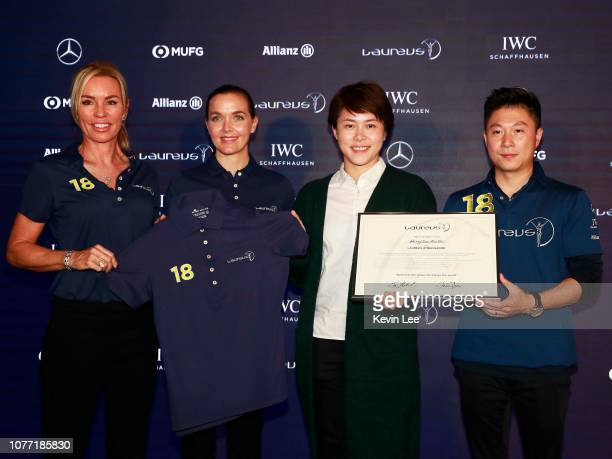 Laureus Ambassador Annabelle Bond Laureus Ambassador Victoria Pendleton and Laureus World Sports Academy member Li Xiaopeng present a certificate and...