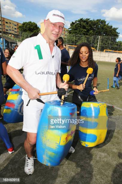 Laureus Ambassador Axel Schulz attends the MercedesBenz Sprinter handover to the Bola Project during 2013 Laureus World Sports Awards on March 10...
