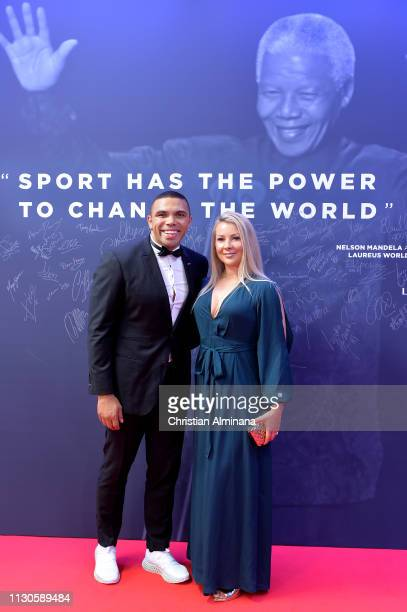 Laureus Ambassador Bryan Habana and guest pose by the Nelson Mandela wall during the 2019 Laureus World Sports Awards on February 18 2019 in Monaco...
