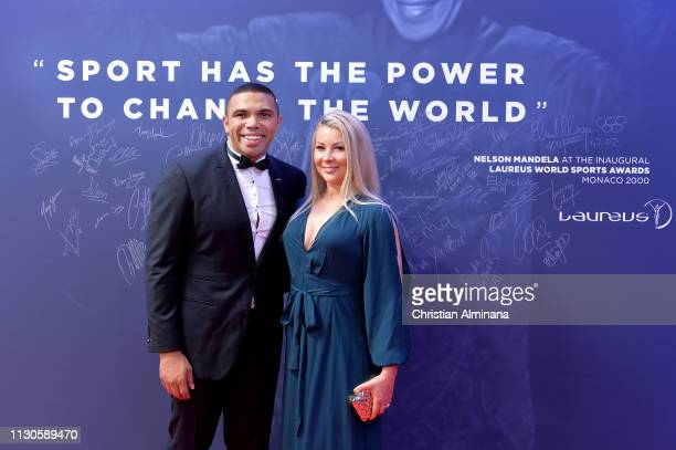 Laureus Ambassador Bryan Habana and guest poses by the Nelson Mandela wall during the 2019 Laureus World Sports Awards on February 18 2019 in Monaco...