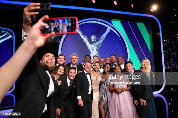 Laureus Ambassador Bryan Habana takes a selfie with guests and Laureus Academy Member Morné du Plessis after the show on February 18 2019 in Monaco...